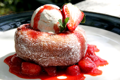 Homemade donuts with strawberry compote